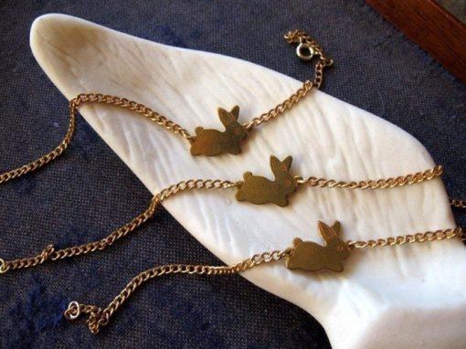 set of two brass bunny bracelets
