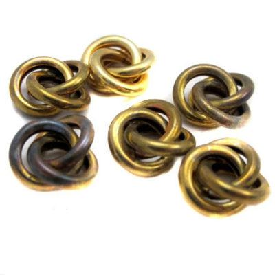 Vintage tarnished knot charm