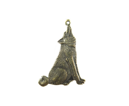 antiqued brass howling wolf charm