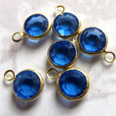 Blue Swarovski crystal in brass setting
