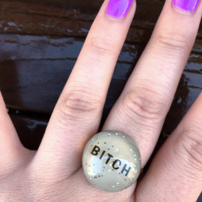 adjustable sparkly ring that says bitch