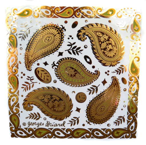 green and gold paisley design on a vintage tile