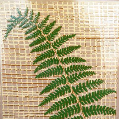 green fern plant on a vintage tile