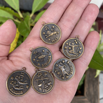 antiqued brass scorpio astrological pendants