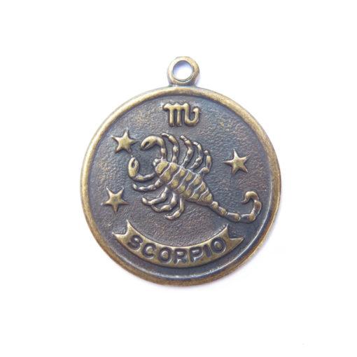 antiqued brass zodiac coin - scorpio