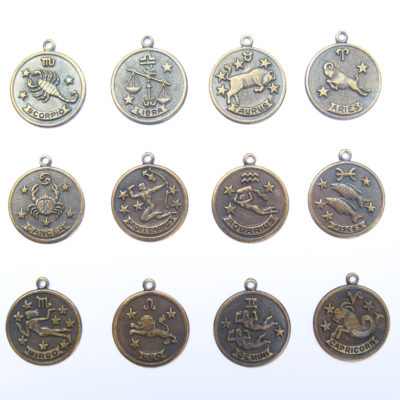 antiqued brass zodiac coins