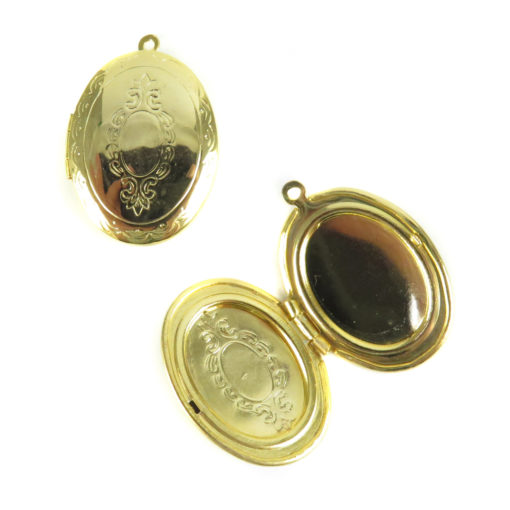 ornate etched gold plated oval locket