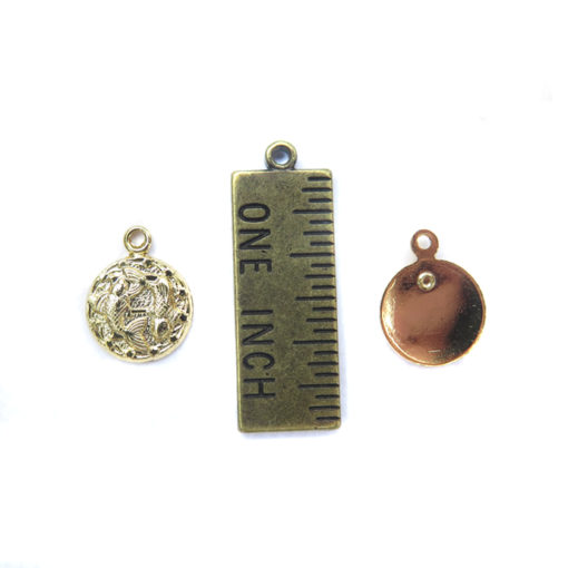 gold plated tiny zodiac with ruler