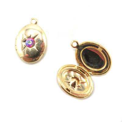 gold plated oval locket with rhinestone